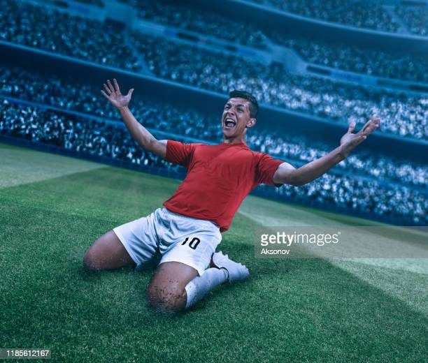 soccer player celebrating victory - international team soccer stock pictures, royalty-free photos & images