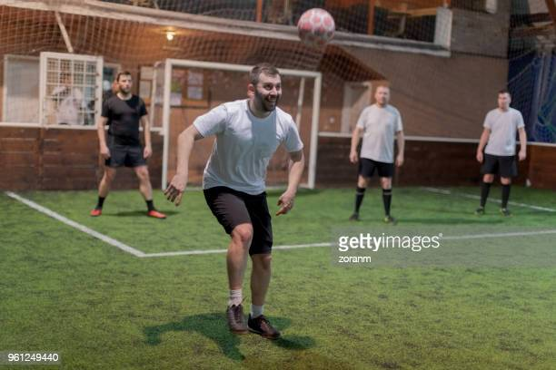 soccer player chasing ball - amateur stock pictures, royalty-free photos & images