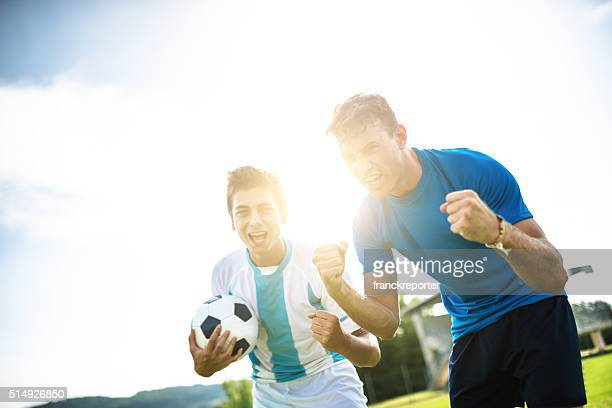 soccer player cheering after the winning