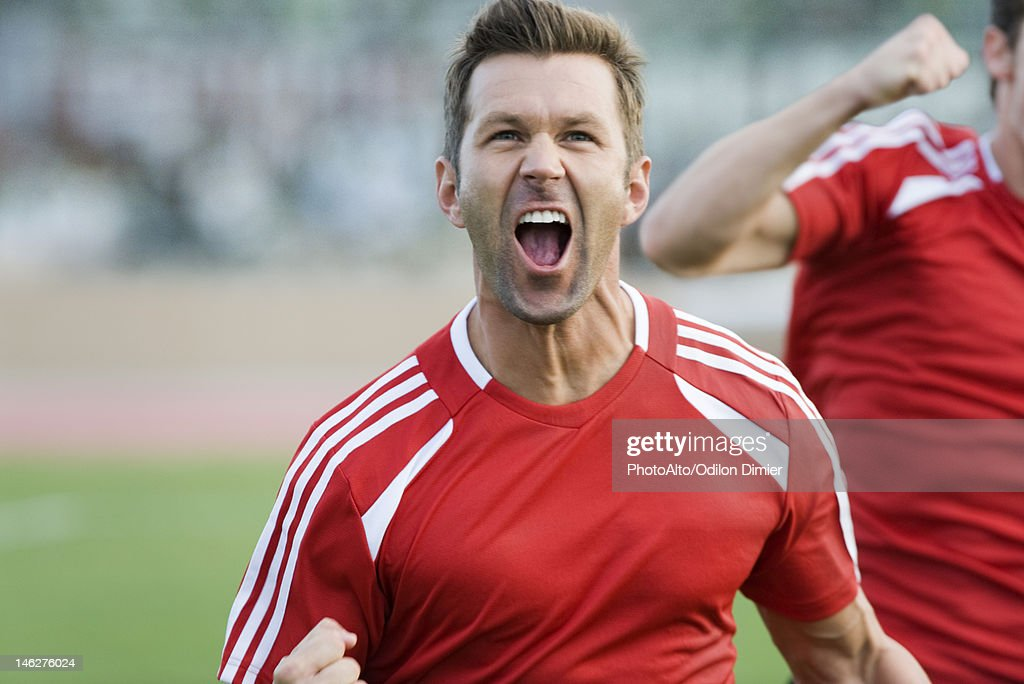 Soccer player cheering : Stock Photo