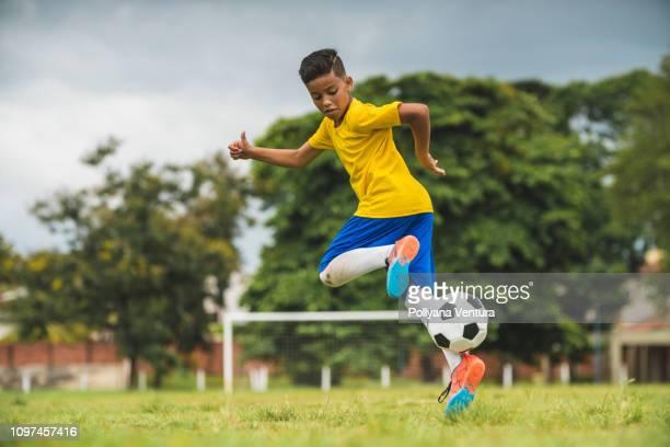 filho de jogador de futebol - sporting term - fotografias e filmes do acervo