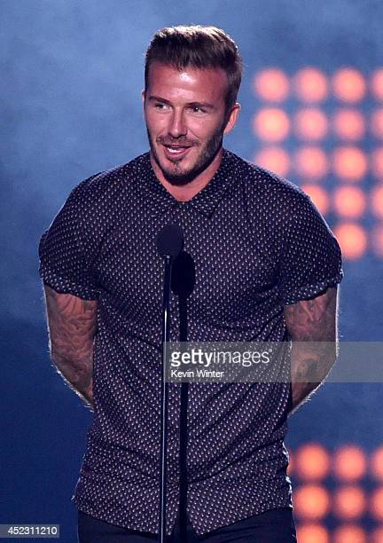 Soccer player David Beckham accepts the Legend Award onstage during Nickelodeon Kids' Choice Sports Awards 2014 at UCLA's Pauley Pavilion on July 17...