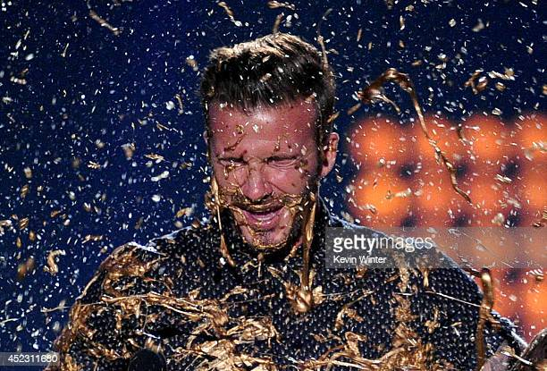 Soccer player David Beckham gets slimed onstage during Nickelodeon Kids' Choice Sports Awards 2014 at UCLA's Pauley Pavilion on July 17 2014 in Los...