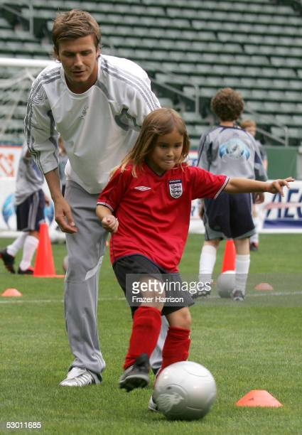Soccer player David Beckham practices with a junior soccer player at the David Beckham Press Conference at the Home Depot Center on June 2 2005 in...