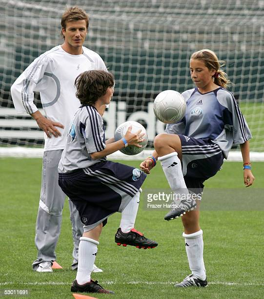 Soccer player David Beckham practices with a junior soccer players at the David Beckham Press Conference at the Home Depot Center on June 2 2005 in...