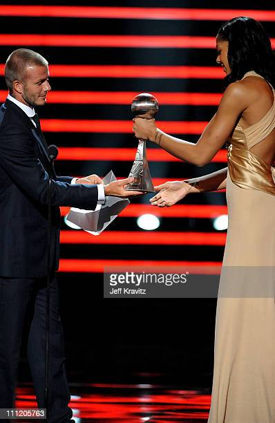 Soccer player David Beckham presents WNBA player Candace Parker the 'Best Female International Athlete' award onstage during the 2008 ESPY Awards...