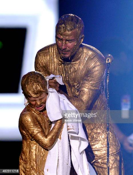 Soccer player David Beckham with Cruz Beckham get slimed onstage during Nickelodeon Kids' Choice Sports Awards 2014 at UCLA's Pauley Pavilion on July...