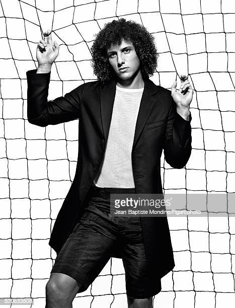Soccer player David Luiz is photographed for Madame Figaro on February 24 2016 in Paris France Coat tshirt and shorts PUBLISHED IMAGE CREDIT MUST...