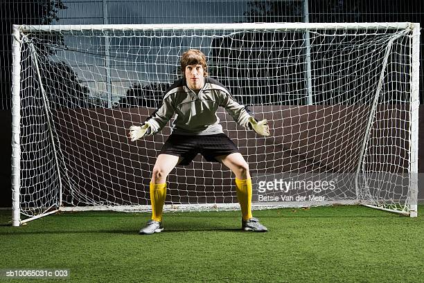 soccer player defending football goal - goalie stock pictures, royalty-free photos & images