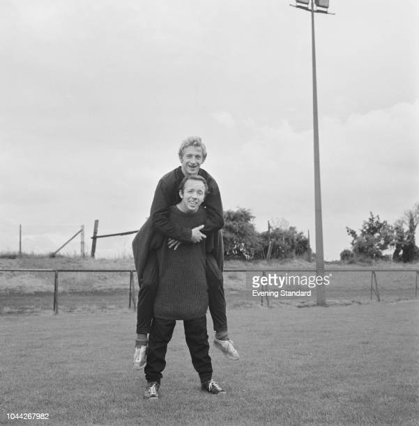 Soccer player Denis Law of Manchester United FC doing a piggyback with fellow soccer player Nobby Stiles UK 1st August 1968