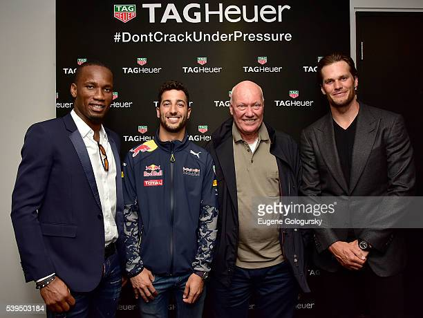 Soccer player Didier Drogba of the Montreal Impact Red Bull Formula 1 Team driver Daniel Ricciardo Tag Heuer CEO JeanClaude Biver Quarterback Tom...