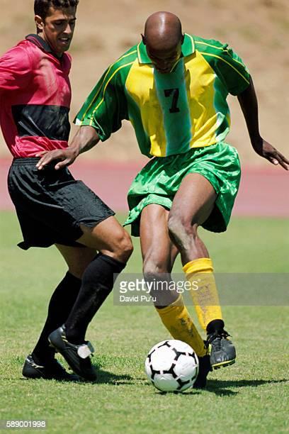 Soccer Player Dribbling Past Opponent