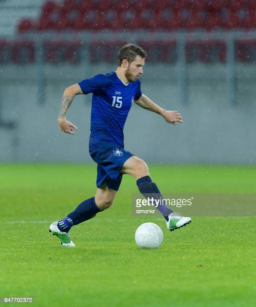 soccer player dribbling - dribbling stock pictures, royalty-free photos & images
