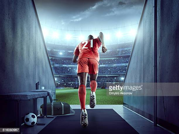 Soccer player enters the stadium