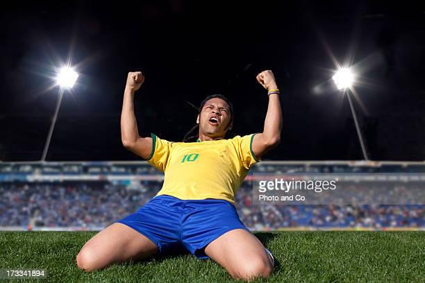 soccer player exulting in stadium