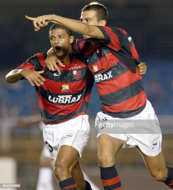 Soccer player Fernando of the Flamengo de Rio team celebrates his first goal with teammate Valnei during the Copa Libertadores competition 27...