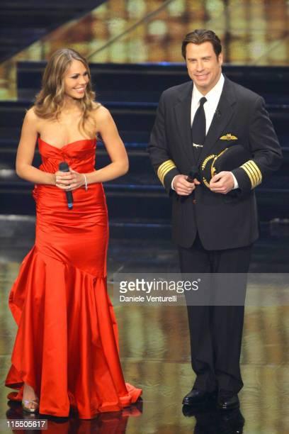 Soccer player Francesco Totti's wife Ilary Blasi and John Travolta