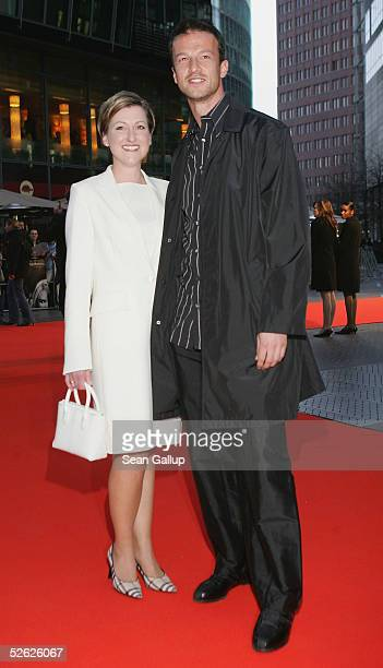 Soccer player Fredi Bobic and his wife Britta arrive for the German premiere of The Interpreter April 13 2005 in Berlin Germany