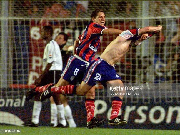 Soccer player from San Lorenzo Lucas Pusineri and Guillermo Franco celebrate their third goal against Corinthians in Buenos Aires 28 November 2001...