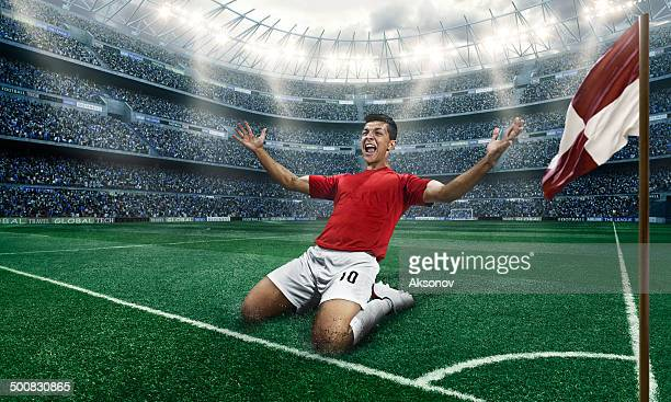 Soccer player happy scoring a goal