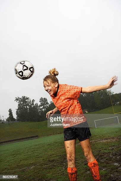 Soccer player heading ball