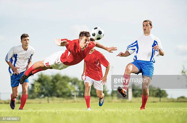 Soccer player heading the ball.