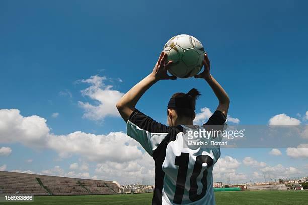 Soccer player holding soccer game