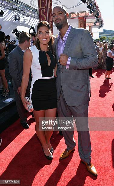 Soccer player Hope Solo and former NFL player Jerramy Stevens attend The 2013 ESPY Awards at Nokia Theatre L.A. Live on July 17, 2013 in Los Angeles,...