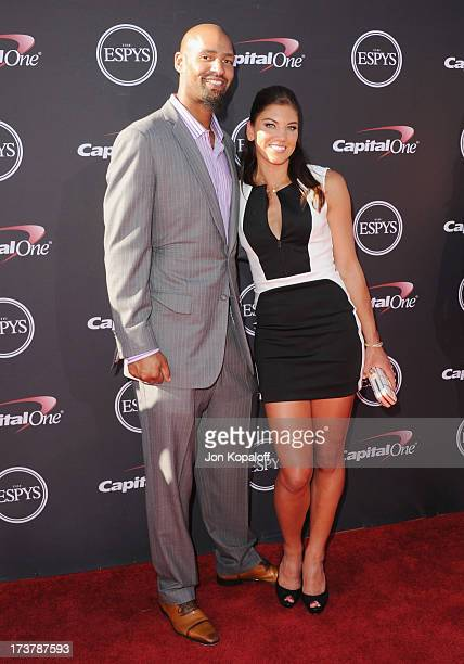 Soccer player Hope Solo and husband Jerramy Stevens arrive at The 2013 ESPY Awards at Nokia Theatre L.A. Live on July 17, 2013 in Los Angeles,...