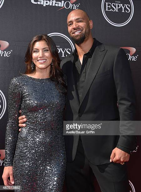 USWNT soccer player Hope Solo and NFL player Jerramy Stevens arrive at The 2015 ESPYS at Microsoft Theater on July 15 2015 in Los Angeles California