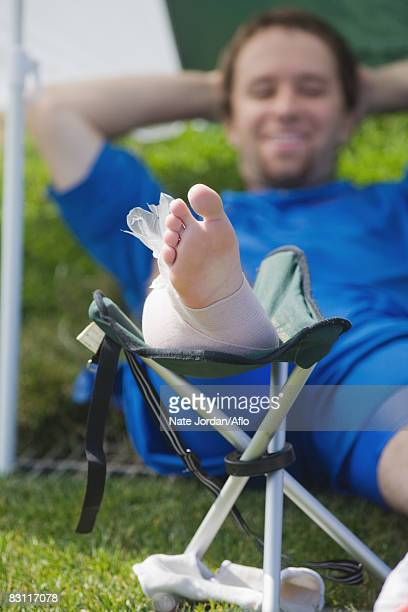 soccer player icing his foot - swollen ankles stock pictures, royalty-free photos & images