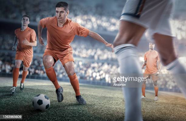 soccer player in action - international team soccer stock pictures, royalty-free photos & images