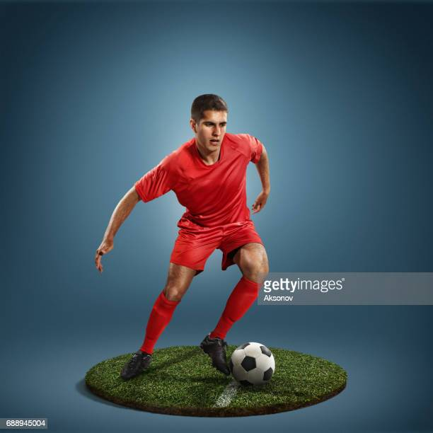 soccer player in action - football player stock pictures, royalty-free photos & images