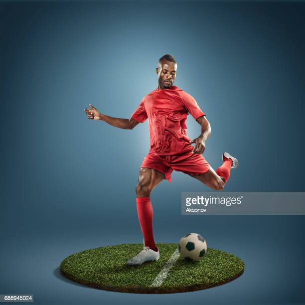 soccer player in action - shootout stock pictures, royalty-free photos & images