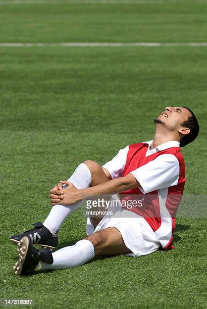 Soccer player in pain with shin injury
