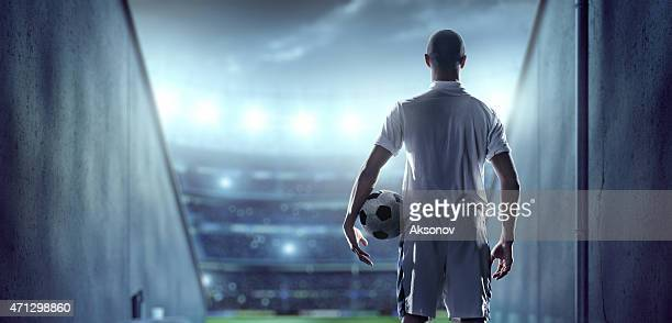 soccer player in players zone of a stadium - football player stock pictures, royalty-free photos & images