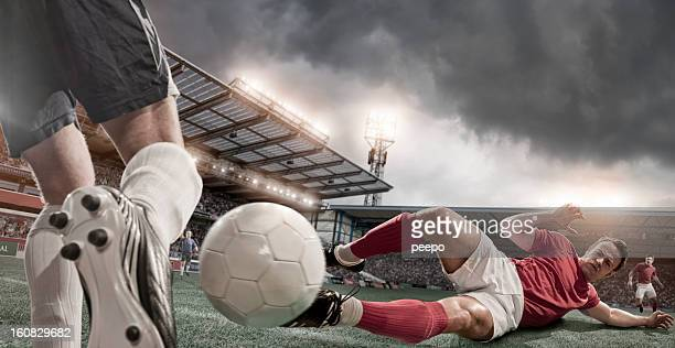 Soccer Player in Sliding Tackle