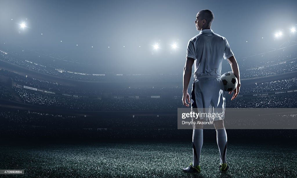 Soccer player in stadium : Stock Photo