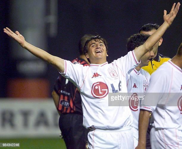 Soccer player Jaramilo of colombia's America de Cali team celebrates his goal against brazil's Atletico de Paranaense team during the Copa...