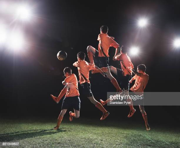 soccer player jumping to ball multiple exposure - multiple exposure sport stock pictures, royalty-free photos & images