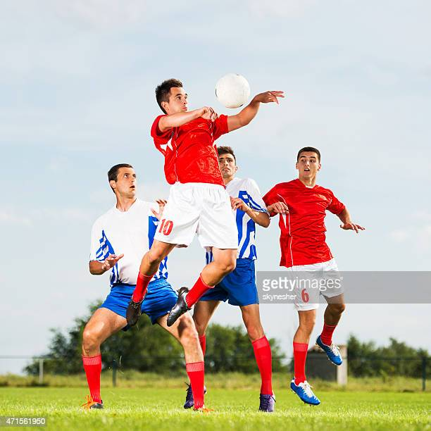 Soccer player jumping to head the ball.