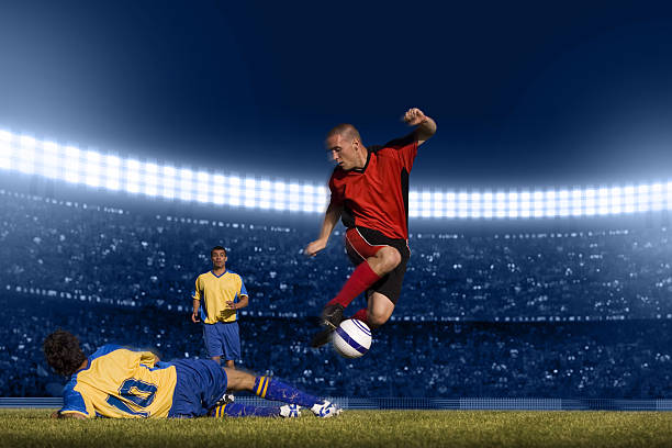 Soccer Player Jumping With Ball Wall Art