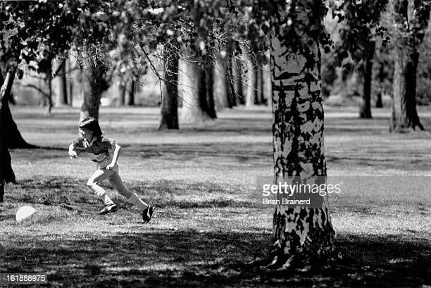 MAY 14 1989 Soccer player Kate Ling age 7 practicing her form in City Park Saturday morning following a game with her team the Firefall