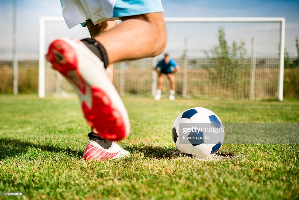 Soccer player kick the ball at the penalty : Stock Photo
