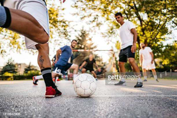 soccer player kicking ball at goal - soccer competition stock pictures, royalty-free photos & images