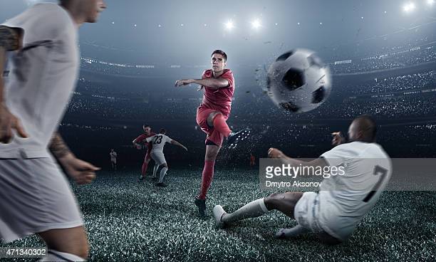 soccer player kicking ball in stadium - shooting at goal stock pictures, royalty-free photos & images