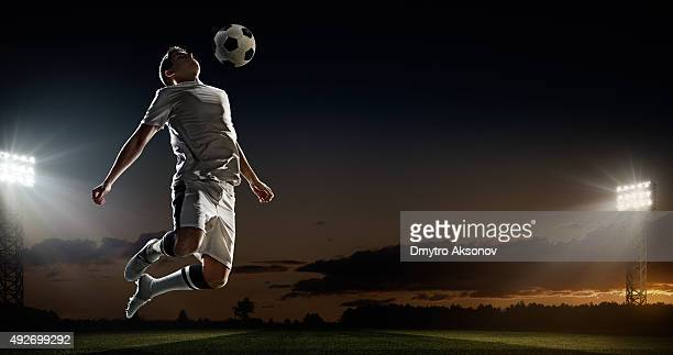 soccer player kicking ball in stadium - international team soccer stock pictures, royalty-free photos & images