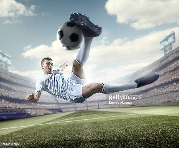 soccer player kicking ball in stadium - shootout stock pictures, royalty-free photos & images