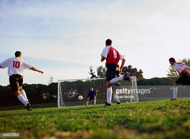 soccer player kicking ball into goal - amateur stock pictures, royalty-free photos & images