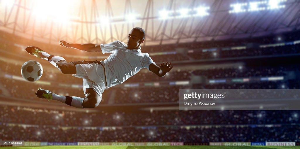 Soccer Player Kicking Ball on stadium : Stock Photo